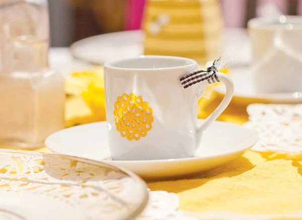 yellow decorated tea cups