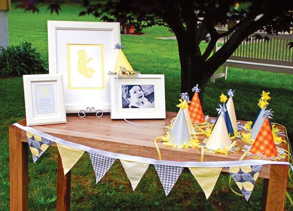 first birthday decorations with party hats and photos
