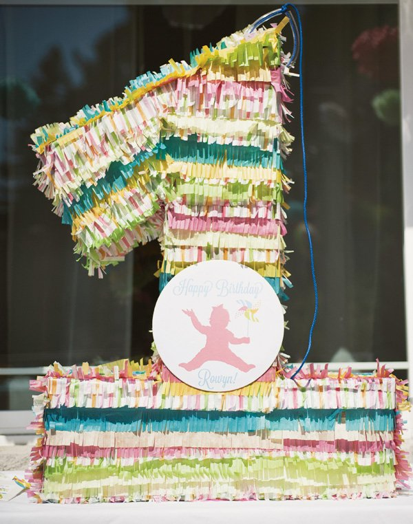 pastel one piñata with homemade fringes