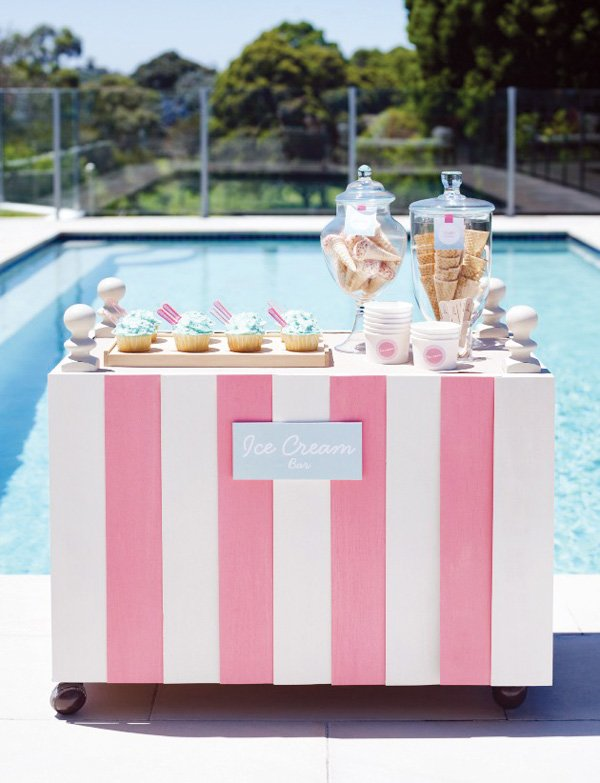 pink pool party with an ice cream bar