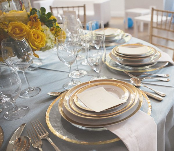 something blue bridal event with gold dishes
