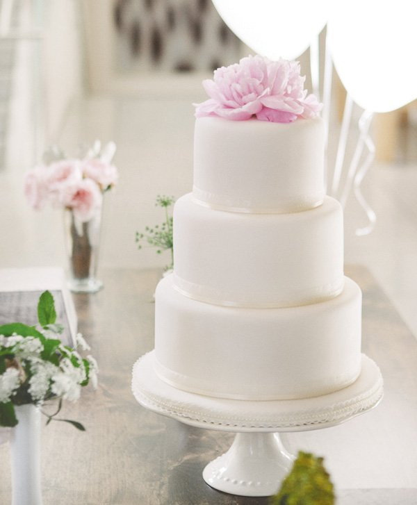 something blue bridal event with a white wedding cake