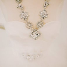 tulle wedding dress with a diamond necklace