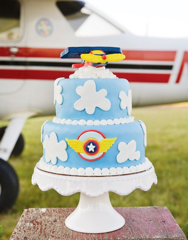 Cloud cake with fondant airplane cake topper