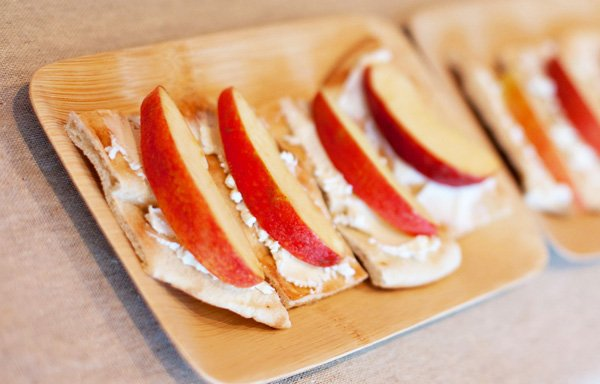 hunger games party ideas: apple slices with goat cheese on pita bread