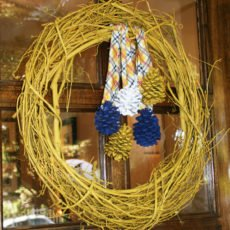 modern nature inspired party with a curry yellow pine cone wreath