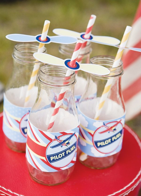 Vintage milk jars with airplane propeller straw flags