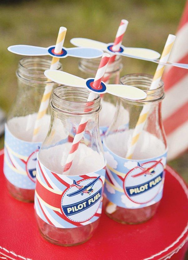 Vintage milk jars with airplane propeller straw flags
