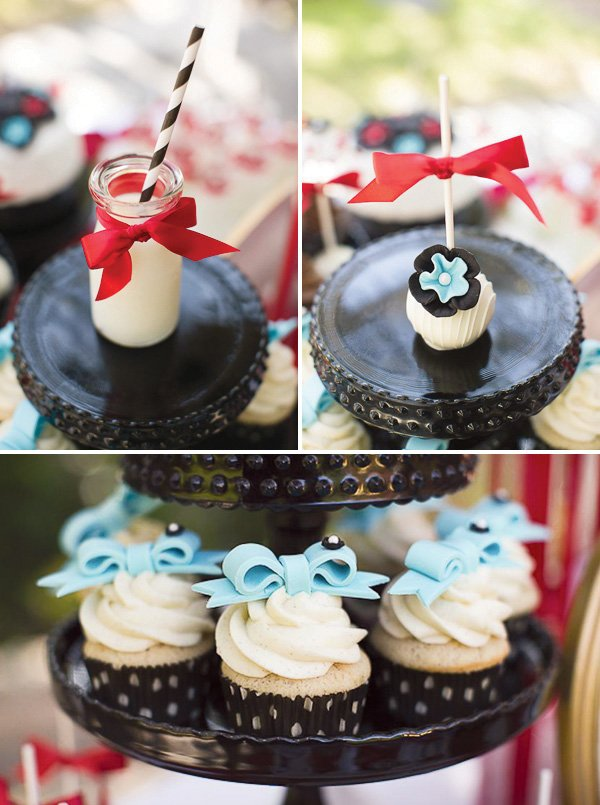 Red and Blue dessert bar with bow cupcake toppers and flower cake pops