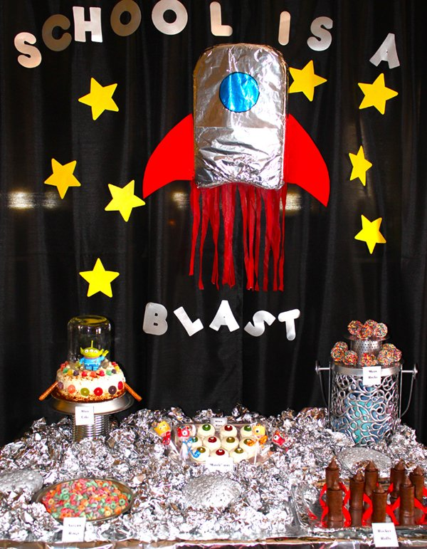 back to school sweets table with space themed sweets