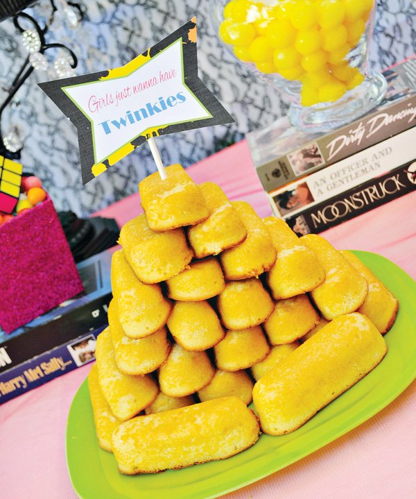 80s inspired dessert table with twinkie tower