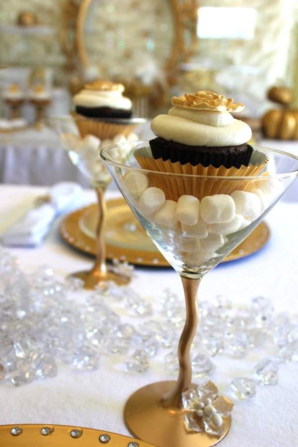 cupcake martini topped with gold fondant flowers