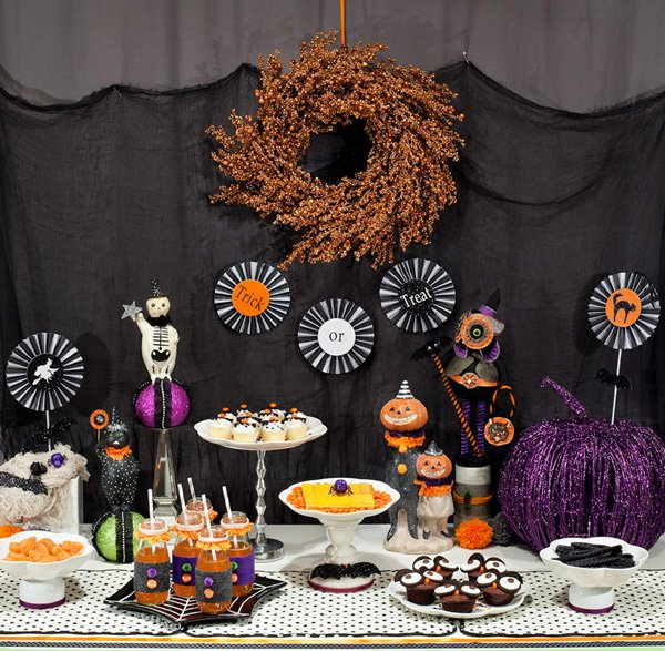 kids halloween dessert table wth pumpkins, owls, and glitter