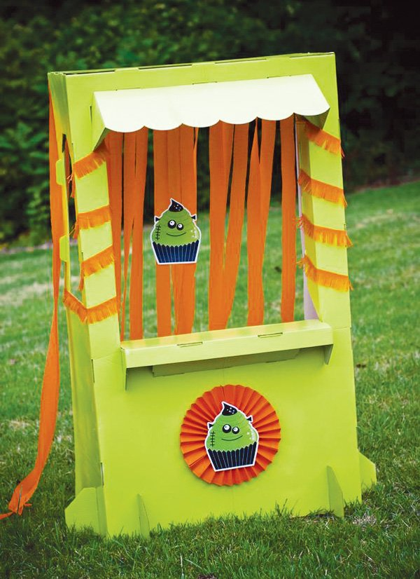 halloween party cupcake stand with orange crepe paper