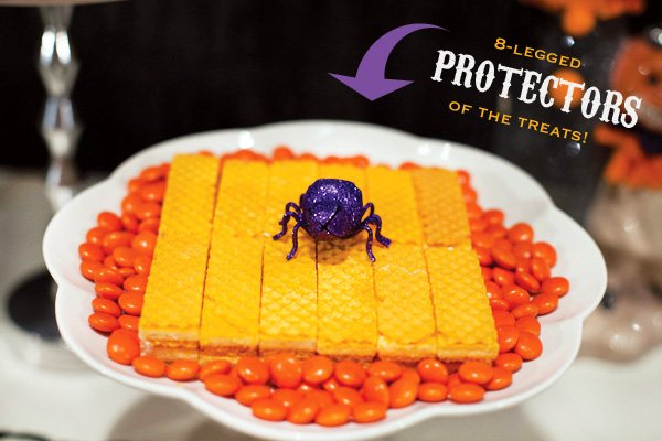 orange halloween treats with purple glittered spider