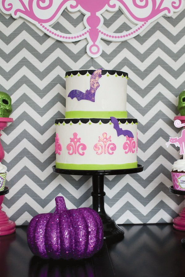 modern halloween party with a glamorous glitter cake