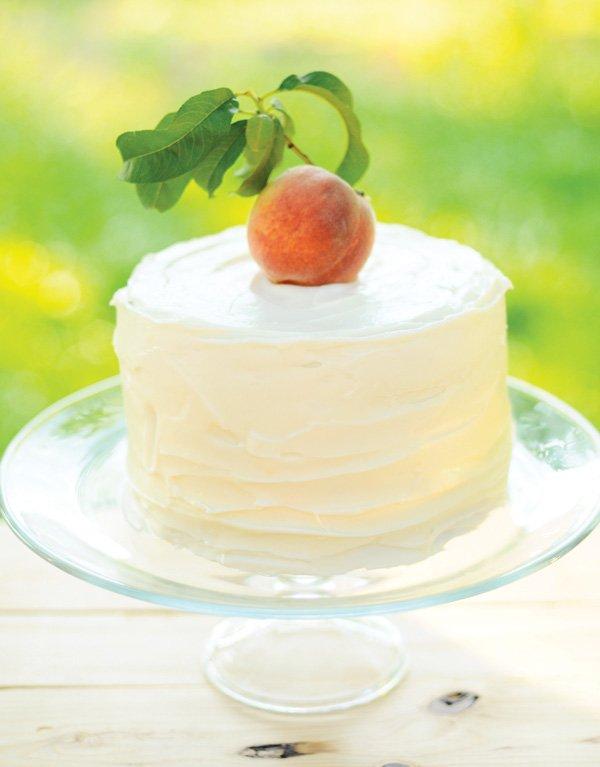 peach first birthday cake
