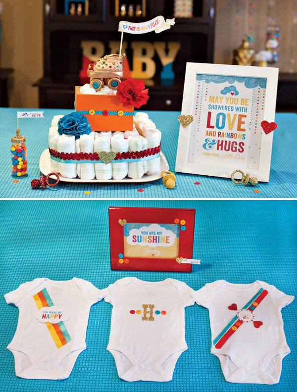 retro rainbow baby shower diaper cake and onesies