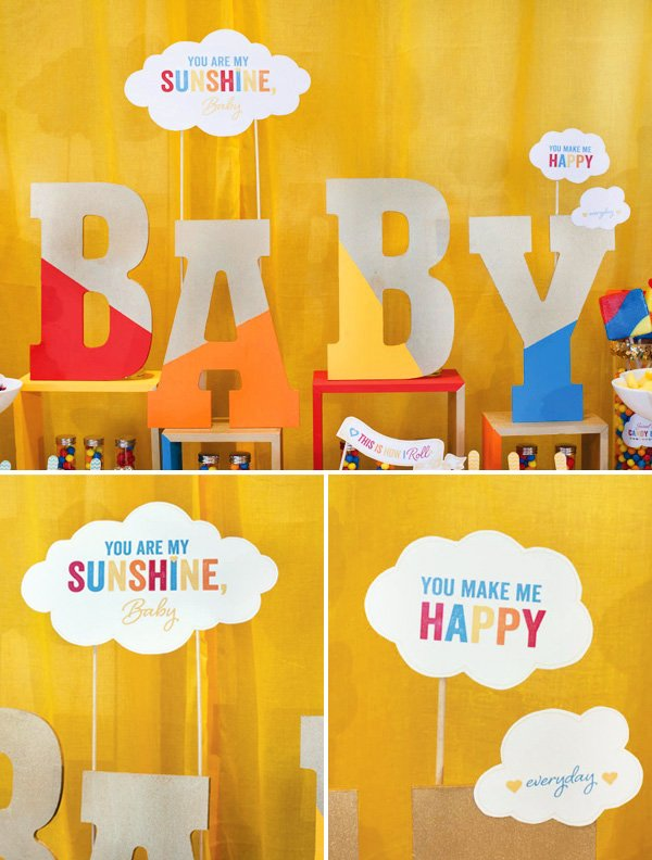retro rainbow baby shower with a yellow backdrop and cut out baby sign