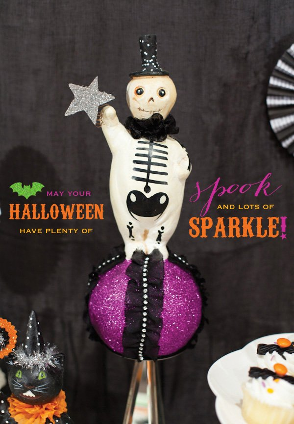 spooky and sparkly halloween party decorations with cute skeleton
