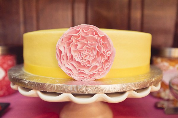 yellow cake with a pink flower cake