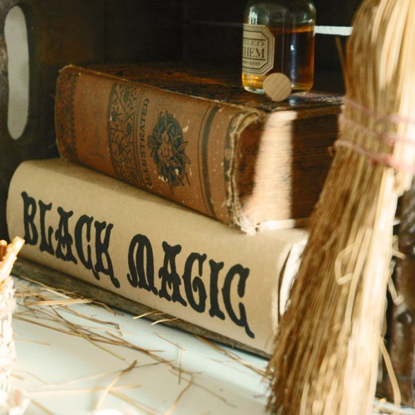 Witch themed Halloween Table with Black Magic DIY Book Cover