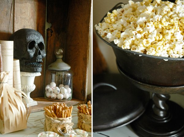 Toil & Trouble Snack Table with skull decor and cauldron filled with popcorn