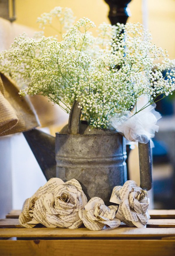 watering can centerpiece and book paper flowers