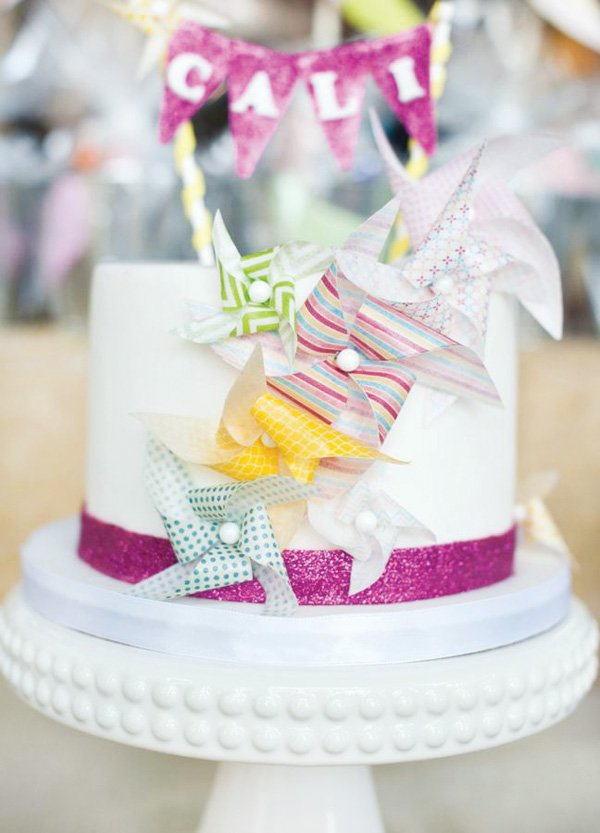 pinwheel birthday cake with mini bunting topper