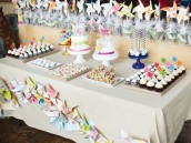 dessert table with pinwheel garland
