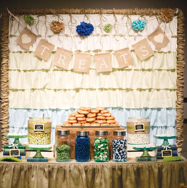 dessert table with a burlap garland and tablecloth