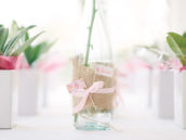 bottle decorated with burlap and ribbon