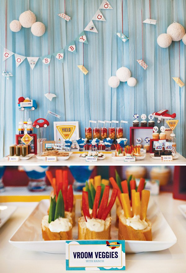 transportation baby shower food and dessert table with cars, airplanes, and trucks
