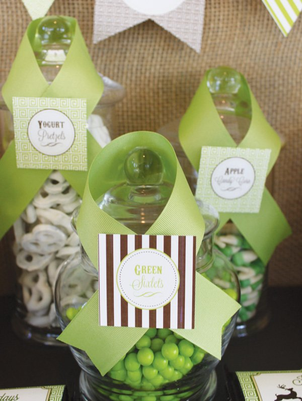 green ribbon wrapped candy jars
