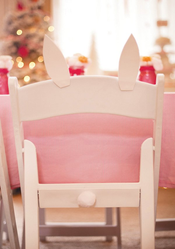 kids chair decorated to look like a bunny - cotton ball tail and foam bunny ears