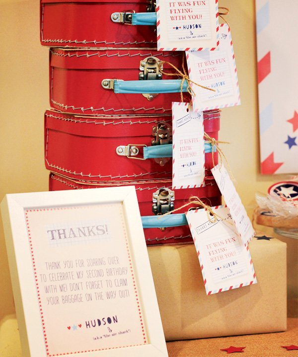 red favor suitcases