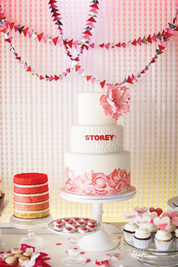 glam pink party with a white cake
