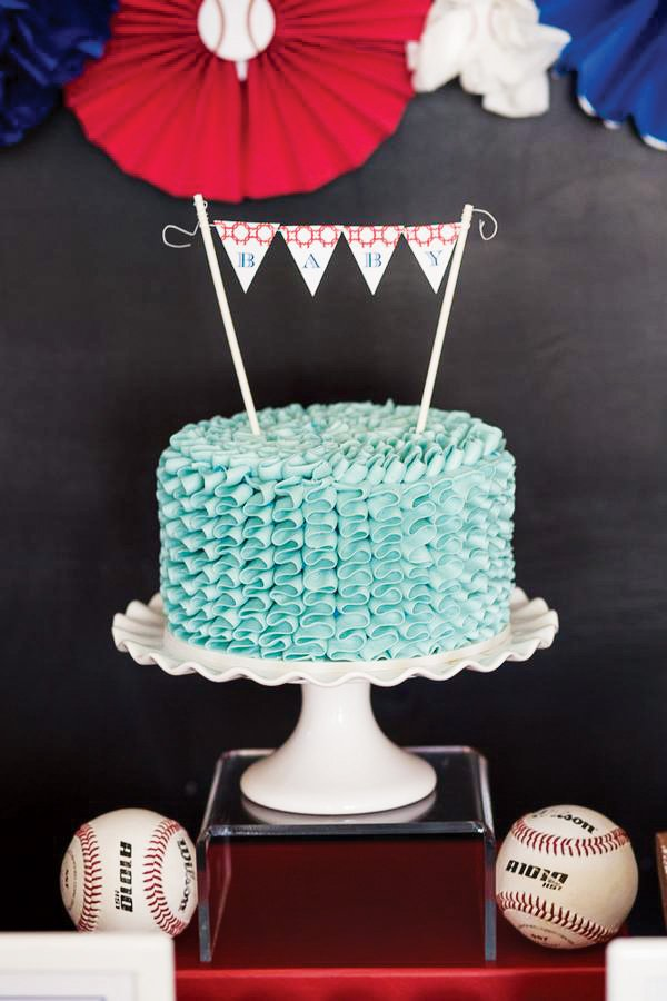 blue ruffle baby shower cake with mini bunting