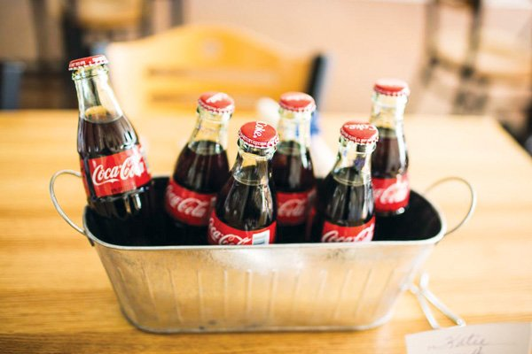 coco cola bottles in a silver bucket
