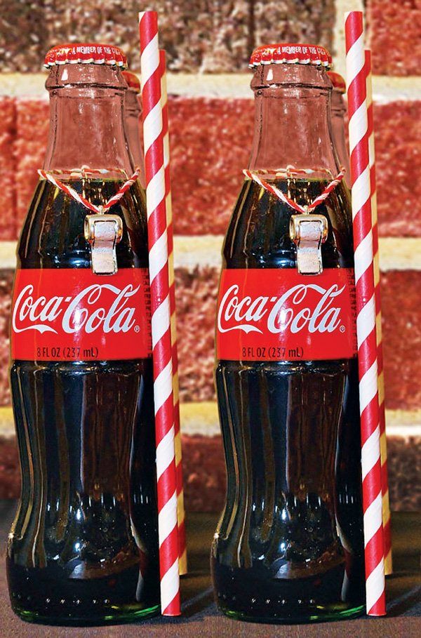 whistle decorated coca cola bottles