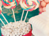 pink and teal swirl lollipops for a valentine's day dessert table