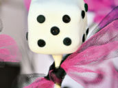 dice cake pop with pink and black ribbon