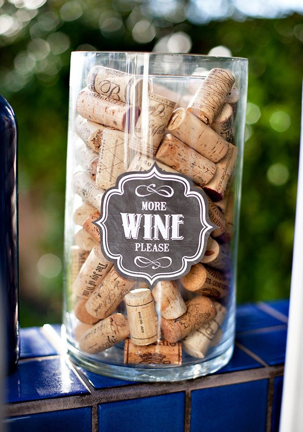 wine corks in hurricane vases