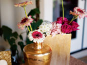 gold vases with pink flowers