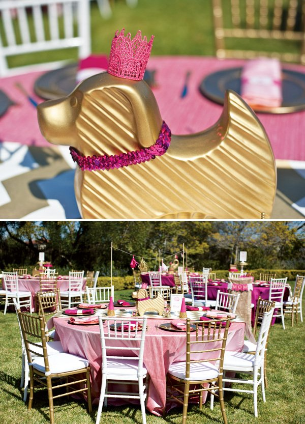 gold dog centerpiece with a pink sequin collar