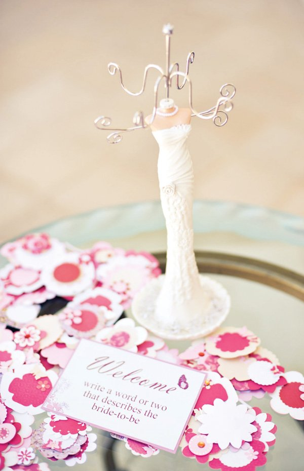 welcome sign with paper flower confetti
