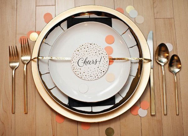 gold and black table place setting