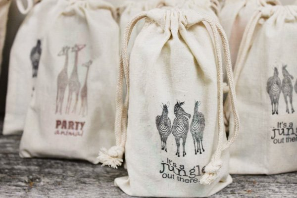 burlap party favor bags with printed animals