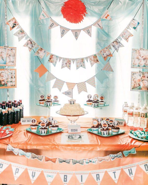 little man birthday party with a bow tie decorated dessert table