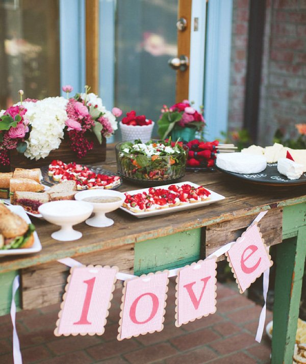 love banner at a bridal shower dessert table